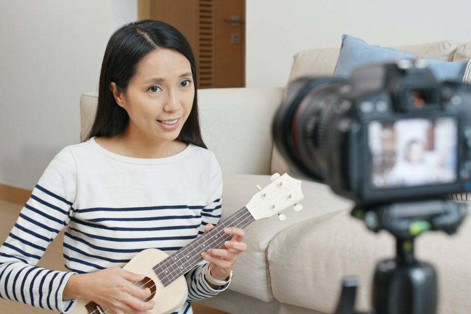 Woman teach ukulele and take a video on camera for social media